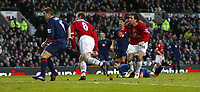 Photo Aidan Ellis.<br /> Manchester United v Portsmouth.<br /> FA Barclays Premiership.<br /> Old Trafford, Manchester.<br /> 26/02/2005.<br /> United's Ruud Van Nistelrooy cheers Wayne Rooney's shot as it goes in for the first goal