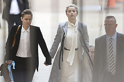 © Licensed to London News Pictures. 21/07/2020. London, UK. American actor AMBER HEARD arrives at the High Court in London where Johnny Depp is in a legal dispute with UK tabloid newspaper The Sun over allegations he assaulted his former wife, Amber Heard. Photo credit: Peter Macdiarmid/LNP