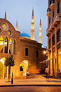 A cafe on Place d'Etoile (Nejmeh Square), with Mohammad Al-Amin Mosque and Saint George Orthodox Cathedral in the Downtown area of Beirut, Lebanon