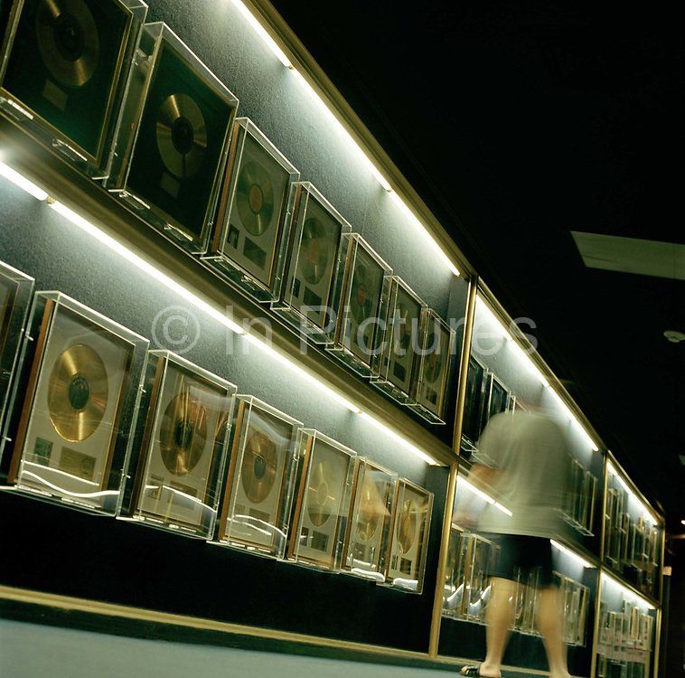 Elvis' collection of best selling records hangs in a corridor at Graceland his home when he was alive and now a museum dedicated to all things Elvis.It would be easy to expect  Graceland to be an over-rated tourist attraction. But as it is  you could go in there Elvis indifferent and come out a fan. The house has been left exactly as it was when Elvis died in 1977. It's not huge, in terms of superstars mansions now and although it is done in showy taste - all shag pile walls, heart shaped beds and white  leather sofas, the design has been left exactly as Elvis created it.<br /> Graceland is located at 3734 Elvis Presley Blvd, Memphis, TN 38116