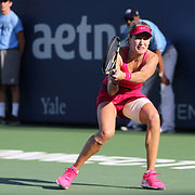 Eugenie Bouchard, Canada, in action against Bojana Jovanovski, Serbia, during the first round of the Connecticut Open at the Connecticut Tennis Center at Yale, New Haven, Connecticut, USA. 18th August 2014. Photo Tim Clayton