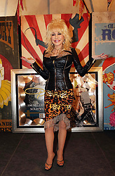© Licensed to London News Pictures. 29/06/2014. Somerset, UK. Dolly Parton performs at Glastonbury 2014.  Dolly Parton has offered to adopt a dog that was left behind at Glastonbury. The American country singer said she would take the white lurcher back to the US if its owner was not found.. Photo credit : Jason Bryant/LNP