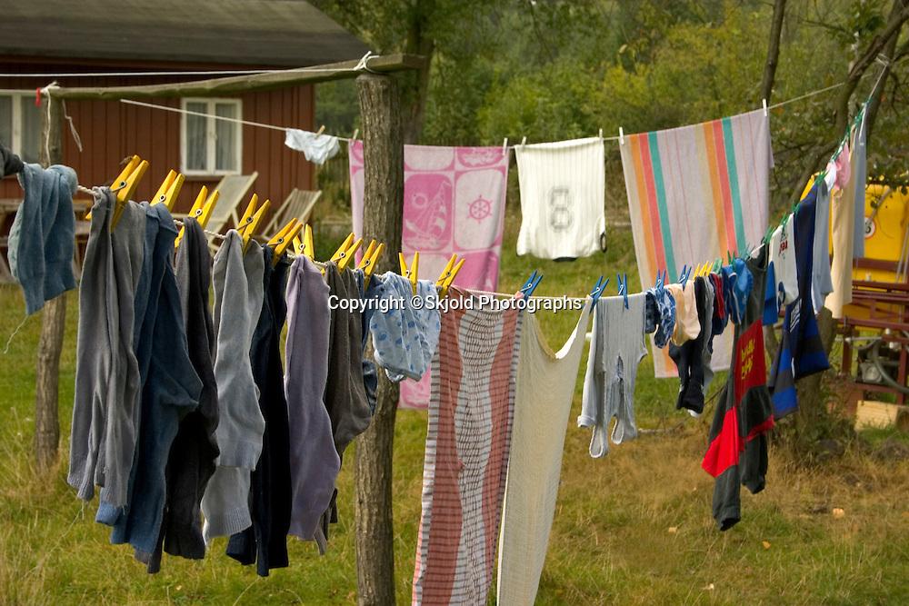 Clothes hanging in Polish farm yard.  Zawady  Central Poland