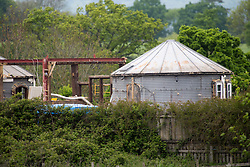 © Licensed to London News Pictures. 03/06/2016. Honeycrock Lane, Redhill, Surrey, UK. After 10 years farmer Rob Fidler has lost his battle to keep his farm house and has had to demolish it due to him not getting planning permission to build it.  Photo credit: Presspics/LNP