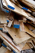 piled up used wood at a construction site