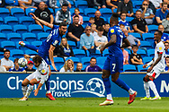 Cardiff City forward Kieffer Moore  (10) competes for a ball with  Bournemouth midfielder Ben Pearson (22) during the EFL Sky Bet Championship match between Cardiff City and Bournemouth at the Cardiff City Stadium, Cardiff, Wales on 18 September 2021.