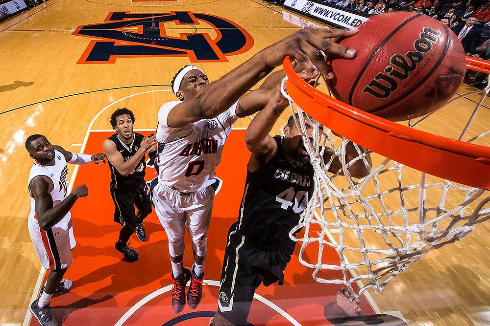 Auburn's Horace Spencer (0) dunks over Colorado's Josh Scott (40). <br /> Colorado Buffaloes vs. Auburn Tigers at Auburn Arena in Auburn, Ala. on Tuesday, Nov. 17, 2015.<br /> Zach Bland/Auburn Athletics