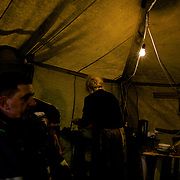 Meals are served inside a tent housing a Ukrainian self-defence group near the Crimean border in Kherson.