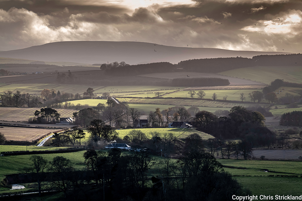 Crailing, Kelso, Scottish Borders, Scotland, UK. 2nd December 2020. Looking south west from Crailinghall near Kelso to the Carter Bar and the Anglo Scottish Border on the skyline.