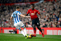 Manchester United's Paul Pogba and Huddersfield Town's Erik Durm
