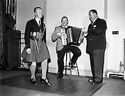 Rory O'Connor (dancing) with Accordion Player (unknown) and DIn Joe/Denis Fitzgibbon (on right) star in Take the Floor.11/04/1957..Popular Irish radio broadcaster of the 1950s Denis ?Din Joe? Fitzgibbon was born in Cork city and educated at the Presentation College. He played rugby for Dolphin and Munster. He studied accountancy and after working for Batchelors Foods in Dublin joined the motor trade with Ford's Smithfield Motors, working his way up to manager of Toyota Ireland in 1975..But his distinctive clear voice blended with a Cork accent was to give him a second career in radio. In the early 1950s he took part in a quiz show with Joe Linane and ?Din Joe? was introduced to the Irish public..By 1953 he was hosting his own recorded radio entertainment show, Take the Floor, the main feature of which was Irish dancing (music supplied by the Garda Ceili Band) but including music, storytelling and humour. His programme, hosted at venues throughout the country, made household names of the Rory O'Connor Dancers (see video below), harpist Kathleen Watkins (later to marry Gay Byrne) and actor Eamonn Keane..Din Joe has gone down in modern Irish lore as the radio host who introduced Irish dancing on radio. His live style was so vivid that it seemed audio-visual. As can been seen in a section of the YouTube video, he also used to call out the moves in the same manner as was done at American barn dances..Apart from Take the Floor, he would go on the host Round the Fire and Can You Beat It?, a series that inspired his book of humour Laughter Unlimited With Din Joe, published by Mercier in 1957. His stories and anecdotes took a wry look at aspects of life at home and abroad..Din Joe knew his strengths and didn't take to television work in the 1966 on a show called Be My Guest and returned to radio. Long after his show ceased in 1978, mere mention of ?Din Joe? or Take the Floor would raise quizzical eyebrows at the mere thought of dancing on the radio..Denis