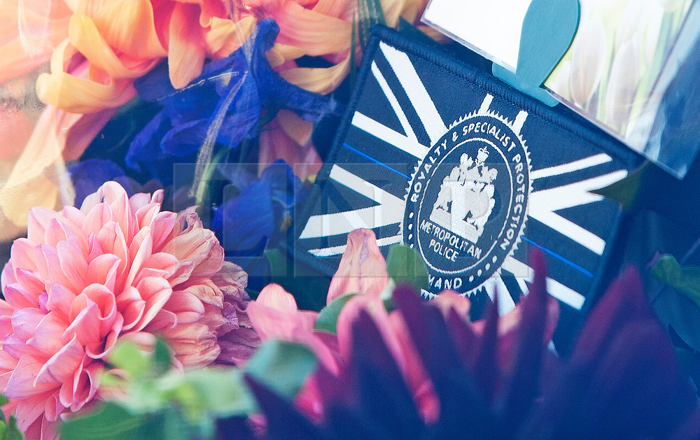 ©Licensed to London News Pictures 28/09/2020  <br /> Croydon, UK. Flowers and a badge from Royal protection officers for Sgt Matt Ratana at Croydon Custody Centre. The murder investigation continues after the death of police sergeant Matt Ratana at the Croydon Custody Centre in South London last week. Photo credit:Grant Falvey/LNP