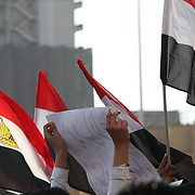 Surrounded by Egyptian flags, a protester makes her demands known during the Day of Justice and Cleansing in Cairo's Tahrir Square.