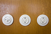 Socialist light switches in the preserved office of former Minister in charge of GDR secret police chief, Erich Mielke - an exhibit in 'Haus 1' the ministerial headquarters of the Stasi secret police in Communist East Germany, the GDR. Built in 1960, the complex now known as the Stasi Museum. Before the fall of the Wall, it was a 22-hectare complex of espionage whose centrepiece is the office and working quarters of the former Minister of State Security, Mielke who considered their role as the 'shield and sword of the party', conducting one of the world's most efficient spying operations against its political dissenters during its 40-year old socialist history. After the fall of the socialist state, Mielke was sentenced to 6 years in prison and died in 2000, aged 92. During Hitler's Third Reich, the Gestapo had one agent for every 2,000 citizens whereas the Stasi had approximately an spy for every 6.5. Here at the Stasi HQ alone 15,000 were employed plus the many regional stations. German media called East Germany 'the most perfected surveillance state of all time' - administered from this complex of offices.