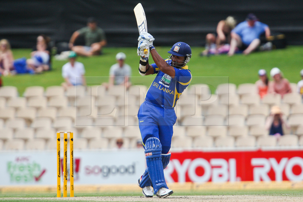 © Licensed to London News Pictures. 14/02/2012. Adelaide Oval, Australia. .Kumar Sangakkara plays a pull shot during the One Day International cricket match between India Vs Sri Lanka. Photo credit : Asanka Brendon Ratnayake/LNP
