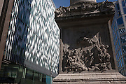 The Monument and modern architecture in the City of London. This old pillar commemorates the great Fire of London in 1666, a date sealed in the capital's history because it burned the central parts of the city of London, gutting the medieval area inside the old Roman city wall.  It consumed 13,200 houses, 87 parish churches, St Paul's Cathedral and most of the buildings of the City authorities. It is estimated to have destroyed the homes of 70,000 of the City's 80,000 inhabitants.