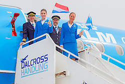 Inverness Airport welcomed KLM's Inaugural flight from Amsterdam. To celebrate the new route, the first flight from Schiphol, Amsterdam was greeted by a water cannon salute upon arrival.  On board were Barry ter Voert, Senior Vice President, Air France KLM European Markets and Wilco Swejen, Director for Aviation Marketing, Schipol Airport.  Provost Helen Carmichael, The Highland Council, Inglis Lyon, Managing Director of Highlands and Islands Aiports and Drew Hendry MP (Inverness, Nairn, Badenoch and Strathspey) met the delegation, officially welcoming the group to the Highlands. <br /> <br /> Pictured: Crew waves flags<br /> <br /> Malcolm McCurrach | EEm | Tue, 17, May, 2016