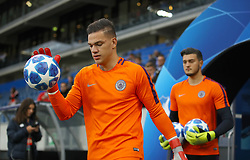 Manchester City goalkeeper Ederson heads out onto the pitch ahead of the match