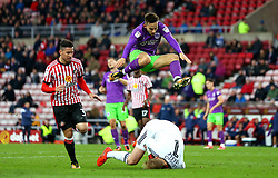 Josh Brownhill of Bristol City jumps over Jason Steele of Sunderland - Mandatory by-line: Robbie Stephenson/JMP - 28/10/2017 - FOOTBALL - Stadium of Light - Sunderland, England - Sunderland v Bristol City - Sky Bet Championship