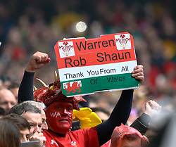 A Wales fans shows his gratitude to the coaches<br /> <br /> Photographer Simon King/Replay Images<br /> <br /> Six Nations Round 5 - Wales v Ireland - Saturday 16th March 2019 - Principality Stadium - Cardiff<br /> <br /> World Copyright © Replay Images . All rights reserved. info@replayimages.co.uk - http://replayimages.co.uk