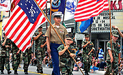 June 29, 2013, Oceanside, California, USA_ 9 year old Gunner Steele, of the Young Marines of Camp Pendleton, carries a flag as he marches in the Oceanside Independence Day Parade. He lives in San Marcos.  Photo Credit: CHARLIE NEUMAN/U-T San Diego/ZUMA Press