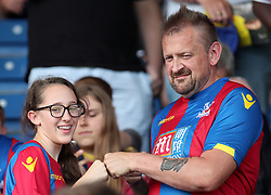 Crystal Palace fans in the stands show their support during a pre season friendly match at The Kassam Stadium, Oxford.