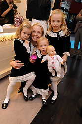 AIMEE SALMI and her daughters, left to right, CELINE, TATIANA and NICOLETTE at a party to celebrate the opening of Pincess Marie-Chantal of Greece's store 'Marie-Chantal' 133A Sloane Street, London on 14th October 2008.