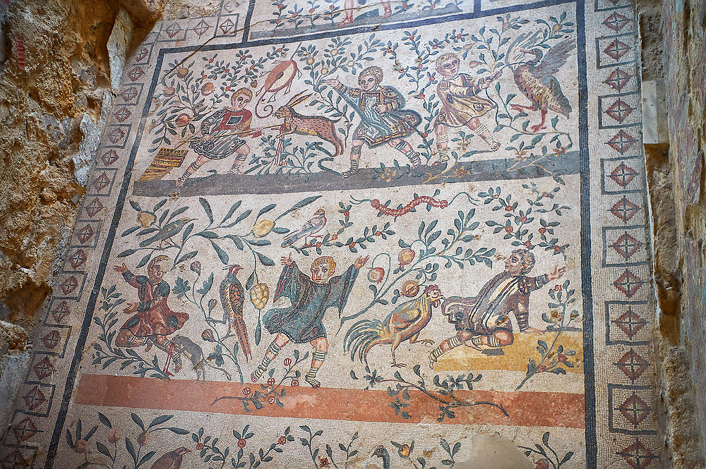 Wide picture of the Roman mosaics of the Room of the Chidrens's Hunt depicting children hunting animals, room no 44 at the Villa Romana del Casale, first quarter of the 4th century AD. Sicily, Italy. A UNESCO World Heritage Site.<br /> <br /> The Roman mosaic on the floor of the cubicle of the Child Hunt in the Villa Romana del Casale is divided into three registers with a floral theme.<br /> <br /> In the first register boys are spearing a hare with a venabulum ( spear) while to their right another boy has trapped a duckling. <br /> <br /> In the second register tree young hunters are portrayed being attacked by animals, one boy has fallen down having been bitten on the calf by a weasel. The boy in the middle has his hands raised calling for help and to his right a boy is about to be attacked bu a cockerel.<br /> <br /> In the lower register a boy is holding a raised club about to hit a peacock while another boy is spearing a goat and another is using a shield to protect himself from a Great Bustard. .<br /> <br /> If you prefer to buy from our ALAMY PHOTO LIBRARY  Collection visit : https://www.alamy.com/portfolio/paul-williams-funkystock/villaromanadelcasale.html<br /> Visit our ROMAN MOSAICS  PHOTO COLLECTIONS for more photos to buy as buy as wall art prints https://funkystock.photoshelter.com/gallery/Roman-Mosaics-Roman-Mosaic-Pictures-Photos-and-Images-Fotos/G00008dLtP71H_yc/C0000q_tZnliJD08