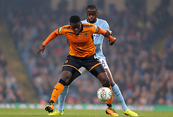 Wolverhampton Wanderers' Alfred N'Diaye (left) and Manchester City's Yaya Toure battle for the ball