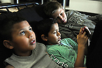 From left, deep in distraction after a hard day at school, friends Jaime Castro, Angel Caballero and Joey Criswell hang out at the Hebbron Family Center in Salinas.