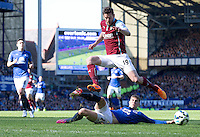 Burnley's Lukas Jutkiewicz loses the ball to a slide tackle from Everton's John Stones<br /> <br /> Photographer Stephen White/CameraSport<br /> <br /> Football - Barclays Premiership - Everton v Burnley - Saturday 18th April 2015 - Goodison Park - Everton<br /> <br /> © CameraSport - 43 Linden Ave. Countesthorpe. Leicester. England. LE8 5PG - Tel: +44 (0) 116 277 4147 - admin@camerasport.com - www.camerasport.com
