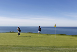 January 26, 2019 - San Diego, CA, USA - Tiger Woods lines up a putt on the 4th hole during the third round of the Farmers Insurance Open at the Torrey Pines Golf Course in San Diego on Saturday, Jan. 26, 2019. (Credit Image: © K.C. Alfred/San Diego Union-Tribune/TNS via ZUMA Wire)