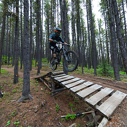 Erica hitting a jump on Race of Spades at Moose Mountain in Alberta, Canada