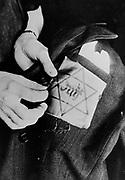 Yellow star badge worn by Jews in Nazi occupied Europe circa 1941