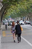 two women hail taxi in shanghai china