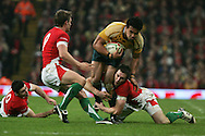 Digby Ioane of Australia is tackled by Stephen Jones. Invesco Perpetual series, Wales v Australia at the Millennium Stadium on Saturday 28th Nov 2009.  pic by Andrew Orchard, Andrew Orchard sports photography, .EDITORIAL USE ONLY