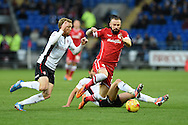 John Brayford of Cardiff city © is challenged by Rotherham's Paul Green (l) . Skybet football league championship match, Cardiff city v Rotherham Utd at the Cardiff city stadium in Cardiff, South Wales on Saturday 6th December 2014<br /> pic by Andrew Orchard, Andrew Orchard sports photography.