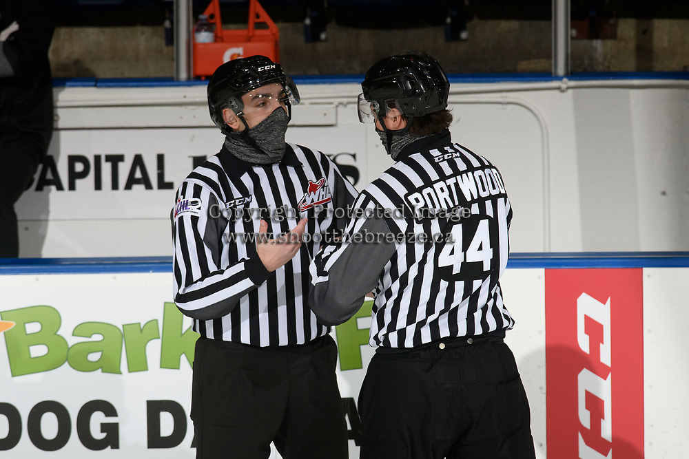 KELOWNA, BC - MARCH 26: Line officials Josh Albinati and Jade Portwood stand on the ice during the first period time out at the Kelowna Rockets against the Victoria Royals at Prospera Place on March 26, 2021 in Kelowna, Canada. (Photo by Marissa Baecker/Shoot the Breeze)