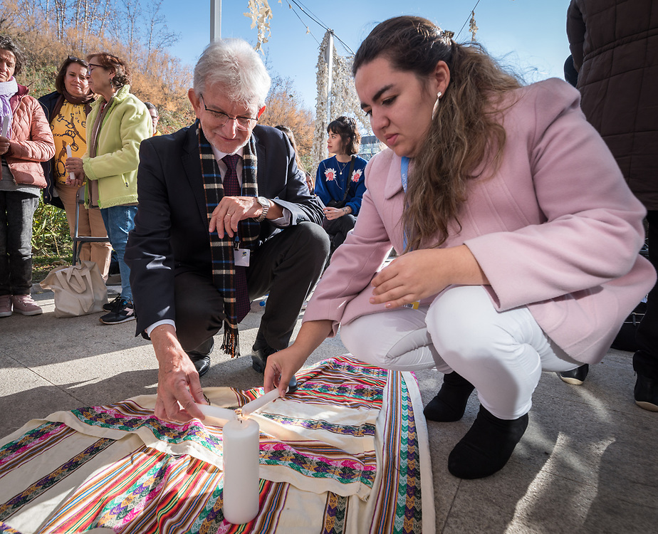 7 December 2019, Madrid, Spain: Lutheran World Federation vice president for Latin America Nestor Friedrich (left) and Lutheran World Federation delegate to COP25 Fernanda Zuñiga, from the Lutheran Church in Chile (right) light candles as people of faith gather in a 'Prayer for the Rainforest' as part of the Cumbre Social por el Clima, on the fringes of COP25 in Madrid, where faith-based organizations continue to urge decision-makers to take action for climate justice.