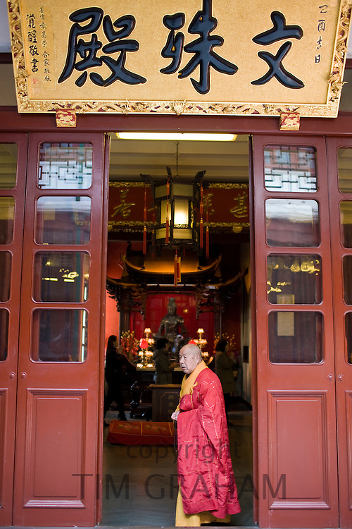 Buddhist monk takes part in religious ceremony at the Jade Buddha Temple, Shanghai, China