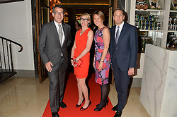 Left to right, MATTHEW DIXON General Manager of The Corinthia Hotel, ISABELLA MacPHERSON, FIONA HARRIS and Renaud Gregoire at a screening of 2 short films as part of the Corinthia Hotel's Artist in Residence held at The Corinthia Hotel, Northumberland Avenue, London on 12th May 2014.