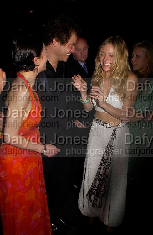 """Helen McCrory,  Dominic West and  Sienna Miller<br />. after-show party following the opening night of  at Wyndham's Theatre of """"As You Like It"""", at Mint Leaf, Suffolk Place, London.  on June 21, 2005. ONE TIME USE ONLY - DO NOT ARCHIVE  © Copyright Photograph by Dafydd Jones 66 Stockwell Park Rd. London SW9 0DA Tel 020 7733 0108 www.dafjones.com"""