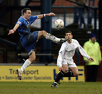 Fotball<br /> FA-cup 2005<br /> Oldham Athletic v Bolton Wanderers<br /> 30. januar 2005<br /> Foto: Digitalsport<br /> NORWAY ONLY<br /> Oldham's Lee Croft (L) controls the ball as Bolton's Anthony Barness looks on