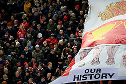 25 November 2017 -  Premier League - Liverpool v Chelsea - Liverpool fans alongside a giant banner featuring numerous images of trophies won by the club - Photo: Marc Atkins/Offside