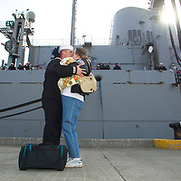 (PPAGE1) Leonardo 2/27/2004  Bill Hill is the first off the USS Detroit as he was rewarded with the ships FIrst Kiss which he gave to his wife Kristina and 8 month old Cheryl  Michael J. Treola Staff Photographer...MJT