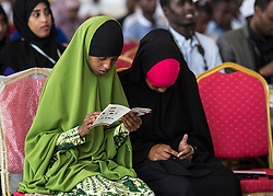 © Licensed to London News Pictures. 4/08/2015. Hargeisa, Somaliland.  Two young girls from Hargeisa study the program during the International Hargeisa Book Festival in the city of Hargeisa within the Republic of Somaliland this week (1 - 6 Aug). <br /> <br /> Over 700 guests are expected to attend along with renowned poets, writers and musicians from both Somaliland, Nigeria and the UK.  As well as the book fair the Women of the World (WOW) event, hosted by Jude Kelly, the Artistic Director of the Southbank Centre in London was held for the first time in the Horn of Africa.   Photo credit : Alison Baskerville/LNP