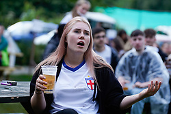 © Licensed to London News Pictures. 7/07/2021. Leeds, UK. A woman reacts during the UEFA Euro 2020 Semi-final football match between England and Denmark at the Myrtle Tavern in Leeds. Photo credit: Ioannis Alexopoulos/LNP