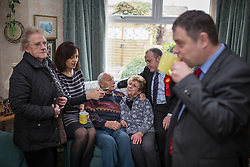 © Licensed to London News Pictures . 30/01/2014. Manchester, UK. L-R June Birds (74 , local pensioner) , Caroline Flint , Ted Amesbury , Dee Amesbury , Mike Kane and Cllr Mike Amesbury . Shadow Secretary of State for Energy and Climate Change , Caroline Flint MP , with PPC Mike Kane in the home of pensioners Dee (82) and Ted (88) Amesbury ahead of the Wythenshawe and Sale East by-election . Photo credit : Joel Goodman/LNP