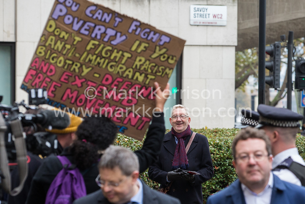 London, UK. 16 November, 2019. Len McCluskey, General Secretary of Unite, is met by freedom of movement activists from Movement for Justice as he arrives at Labour's Clause V meeting. The Clause V meeting, chaired by the party leader and attended by members of the National Executive Committee (NEC), relevant Shadow Cabinet members and members of the National Policy Forum, will finalise the party's general election manifesto. The meeting is named after Clause V of the Labour Party rulebook.