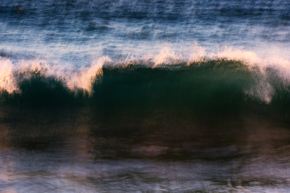 A long exposure elongates the waves that touch the shore of Port Hueneme Beach.